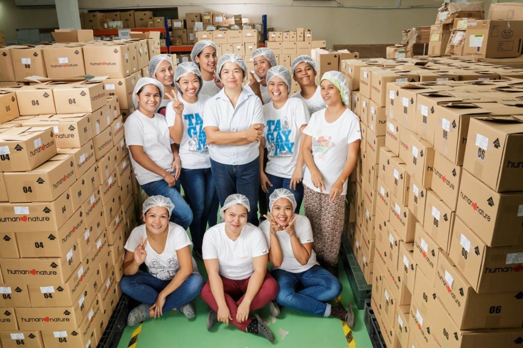 The women workers at the Human Nature Plant with Mildred